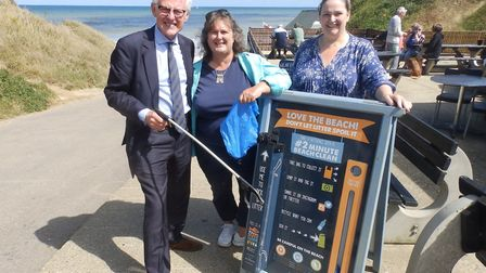 A beach clean at West Runton earlier this year. From left: North Norfolk MP Norman Lamb with distric