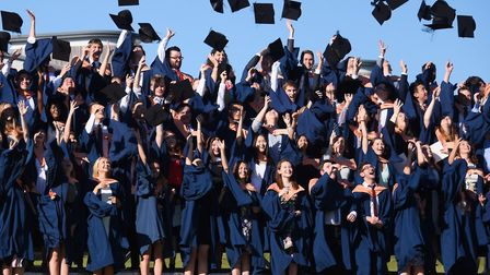 The mortarboards fly at the first day of the UEA graduation ceremonies 2016. Picture: DENISE BRADLEY