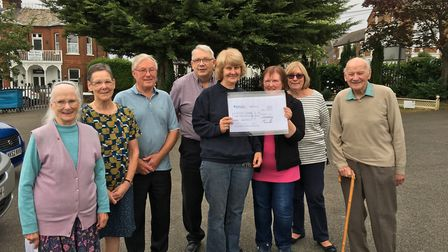 Volunteers present the cheque to centre manager Alison Charles. Picture: RSPCA