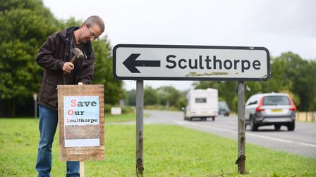 Residents have put up signs all over the village to object to proposed new housing in Sculthorpe. Pi