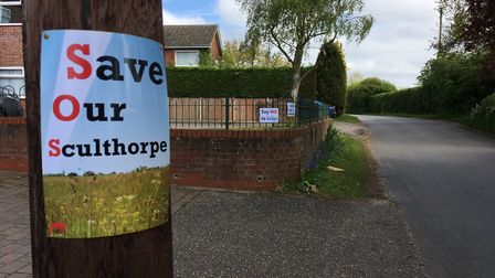 Throughout Sculthorpe signs of protest against the housing plans are evident. Picture: Steve Shaw