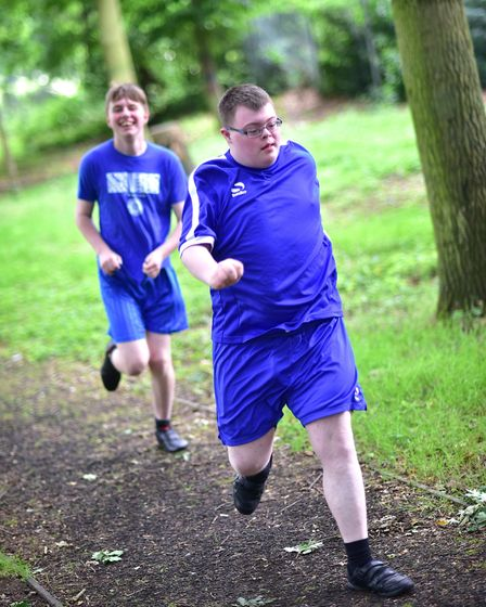 Hall School sports day. David Addy ahead of Josh Lee in the cross-country race.Picture: ANTONY KELL
