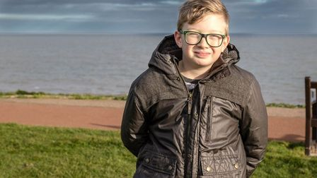 Adam Davison, 12, who has been told he can stay at the special school he loves. Picture: Anne Daviso