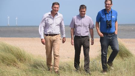 RSPB regional director, James Robinson, left, and lead warden Danny Hercock, right, with E.ON Scroby