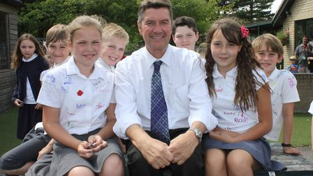 Sheringham Primary Year 6 pupils with teacher Jon Pigney, who is retiring after 29 years at the scho