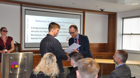 City College Norwich deputy principal Jerry White presents awards to its access course students. Pic