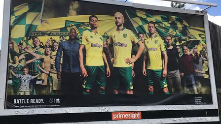 A billboard advertising Norwich City's new home kit has appeared in Ipswich. Picture: ADAM HOWLETT