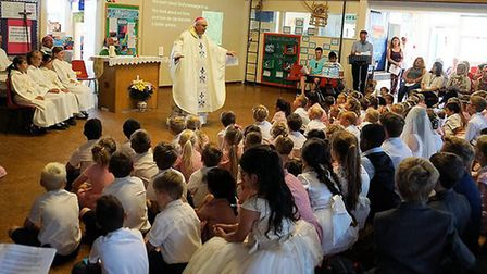 Some of the St Mary's primary school pupils at the 50th anniversary Mass with Bishop Alan. Pictures: