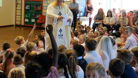 Bishop Alan and some of the St Mary's primary school pupils at the 50th anniversary Mass. Pictures: