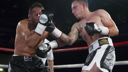 Craig Poxton, right, gets in an uppercut against Ibrar Riyaz at Epic Studios in Norwich. Picture: J