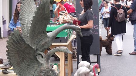 Bungay Antiques Street Fair. Two sculptured swans were among items for sale. Pictures: Terry Reeve