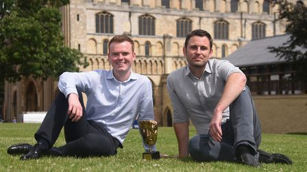 Filmmaker, Rob Whitworth, right, with his BAFTA, and James Shelton, marketing manager at Norwich Cat