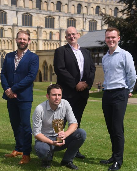 Filmmaker, Rob Whitworth, front, with his BAFTA, and James Shelton, right, marketing manager at Norw