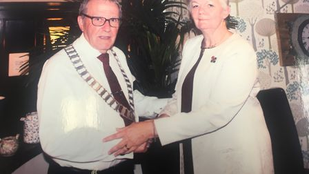 Outgoing Dereham Rotary Club Patricia Barr OBE congratulating the incoming president Paul Sheffield