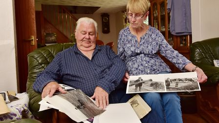 Brian and June Mace look back through old photographs of Bob Mace. Picture: Nick Butcher.