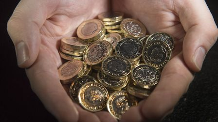 File photo of new 12-sided �1 coins. Picture: Victoria Jones/PA Wire