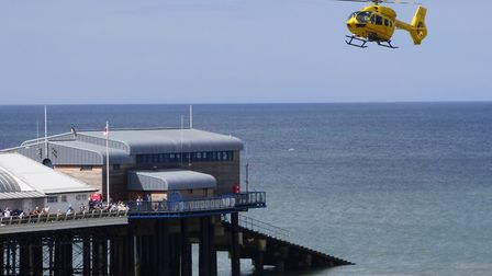 The Air Ambulance laned at Cromer pier after a boy fell from the sea wall. Picture: Paul Russell
