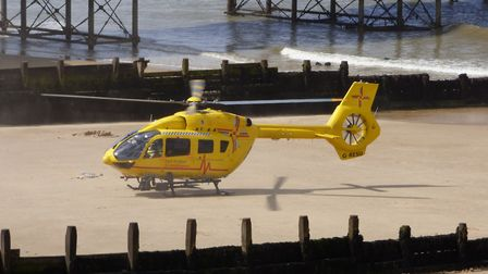 The Air Ambulance landed at Cromer pier after a boy fell from the sea wall. Picture: Paul Russell