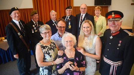 During a special service, Hilda Smith was presented with the Defence Medal by the (R) Lord Lieutenan