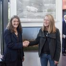 Winning artist Chloe Steele was presented with her prize by Lady Anwen Hurt. Picture: Holt Festival