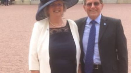 Trevor Brown and Dianne Fernee at Buckingham Palace, when they accepted the Queen's Voluntary Servic