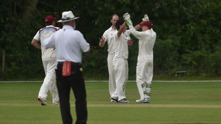 Fakenham celebrate a wicket during Saturday's abandoned game at Old Buckenham. Picture: Sonya Duncan