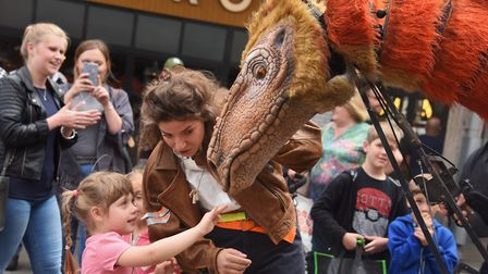 Juliet the Segnosaurus from Dinosaur World, with her handler, Danielle Stagg, amazes youngsters and