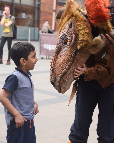 Abdul Rahman, six, comes face to face with Juliet the Segnosaurus from Dinosaur World at Chapelfield
