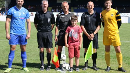 The captains from Ole Frank and Waveney line up with officials prior to the Taylor High Memorial Cup