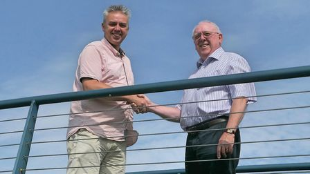 Councillor Martin Richmond (left) and Cllr Barry Fiske (right) on Wroxham Bridge, which separates bo