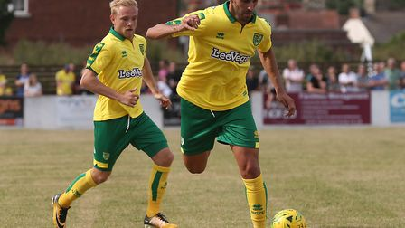 Nelson Oliveira back-heels the ball to Alex Pritchard during Norwich City's 5-1 win at Lowestoft. Pi