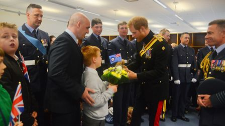 HRH Prince Henry of Wales was presented with an RAF Regiment Bear by Sam (10) with his dad FS Jordan