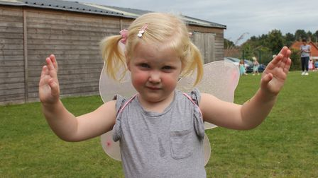 Two-and-a-half-year-old 'butterfly' Evie having fun at Sheringham carnival prince and princess selec