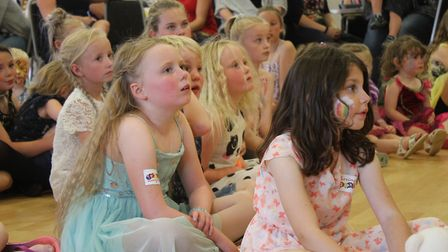 Waiting for the winners to be announced at Sheringham Carnival prince and princess selection disco.