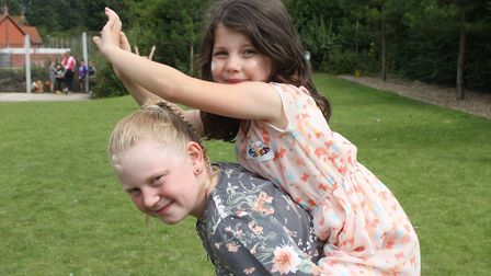 Sophie, 10, and pal Maisie, 7, having fun at Sheringham Carnival prince and princess selection disco