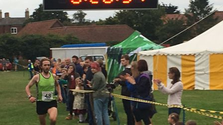 Worstead Festival five-mile run. Dominic Blake heading towards the finishing line. Pictures: David B