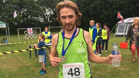 Worstead Festival five-mile run. Dominic Blake with his winner's medal. Pictures: David Bale