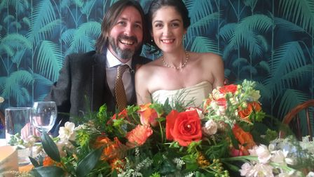 Ben and Mandy Price at their wedding reception with the flowers. Picture: Easton and Otley College