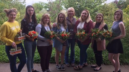 Students from the college with their floral displays for the Price wedding with tutor Gillian Lincol