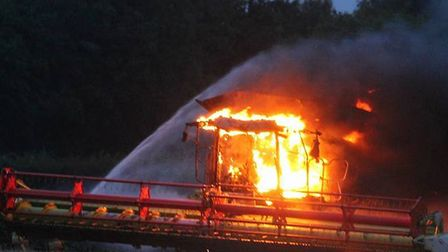Combine harvester on fire in Suton. Picture Beckiee Bolderow's Photography.