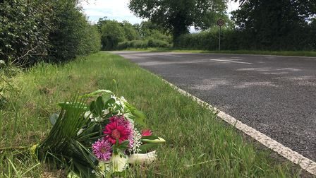 Flowers were left at the scene where a woman was left critically injured in a collision with a polic