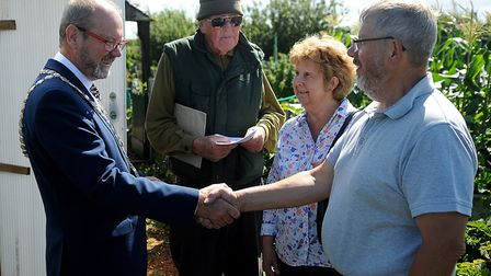 Mayor Adrian Winnington (left) congratulates Mick Wing (right) who won the Green Welly award. Pictur
