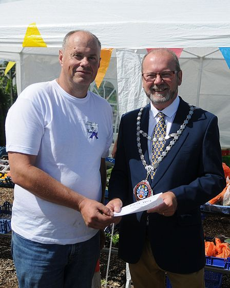 Peter Williams receives his Chairman's Award from the Mayor. Picture: Chris Bishop