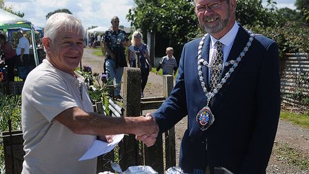 Mick Smith receives a Chairman's Award from the Mayor. Picture: Chris Bishop