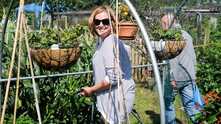 Plot holder Chantelle makes the most of the sunshine. Picture: Chris Bishop