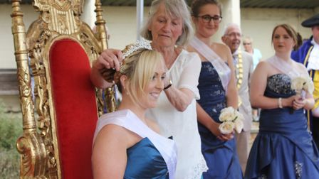 Former district councillor Hilary Nelson crowning Sheringham carnival queen Abby Dowsett-Olby. Pictu