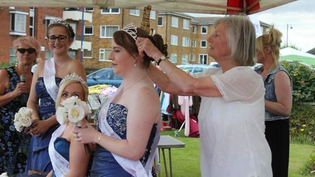 Former district councillor Hilary Nelson crowning Sheringham carnival attendant Natasha Grand. Pictu