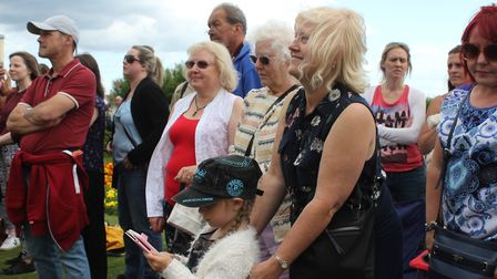 Carnival attendant Natasha Grand's daughter Layla and mum Karen watching the crowning ceremony on th