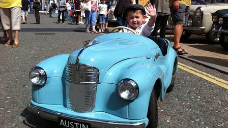 The Diss Heritage Transport Fayre. Joshua Vincent, three, in his model Austin J40, came with father