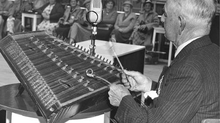 ENTERTAINMENT; MR B. COOPER AGED 77 OF HINGHAM , ENTERTAINING MEMBERS WITH HIS DULCIMER IN THE WINTE